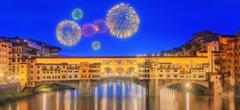 View of medieval stone bridge Ponte Vecchio and the Arno River, Florence - stock photo