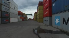 Drone Scene in between containers flying low on an import export harbour. - stock footage