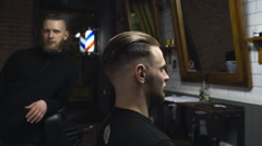 Customer checks work of the barber slow motion Stock Footage