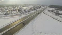 Aerial shot of camera follows the car in winter Stock Footage