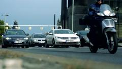 Slowmotion motorcyclist and cars go on road along Narodni muzeum in Prague Stock Footage