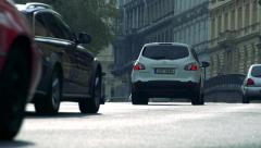 Slowmotion view on cars which departs on road Stock Footage