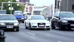 Slowmotion cars go on busy road in town Stock Footage