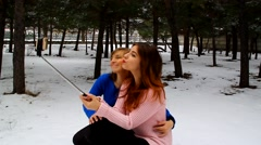 Mother and daughter take a picture of yourself in park on phone outdoors Stock Footage