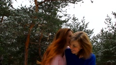 Mother and daughter walking in the park together, hugging, kissing and laughing - stock footage