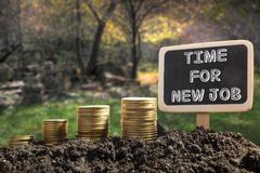 Time For New Job  - Financial opportunity concept. Golden coins in soil - stock photo