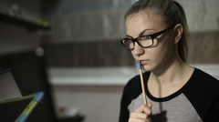 Young student holding a pen near the mouth Stock Footage