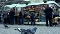 Slowmotion pigeons pecks in front of stand with fast food. Arkistovideo