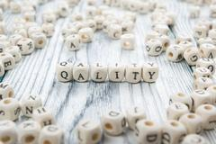 QUALITY  word written on wood block. Wooden ABC Stock Photos