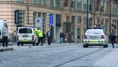 Slowmotion view on police car and policeman on road in town Arkistovideo