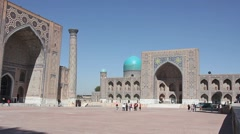 Side view of Registan Square with Ulugh Beg Madrasah and the Tilya-Kori Madrasah Stock Footage