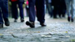 Slowmotion detail of legs of people who walk on sidewalk Stock Footage
