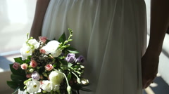 woman in a wedding dress with a bouquet - stock footage