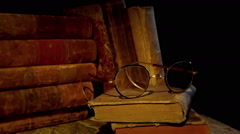 Part of old study, some old books and a pair of glasses. Stock Footage