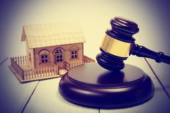 Auction. Law. Miniature House on wooden table and Court Gavel - stock photo