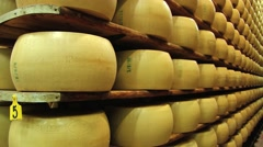 Parmesan mature on the shelves at the cellar in Modena, Italy. Stock Footage