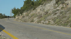 Cyclist Going Down On a Road in Slow Motion Stock Footage