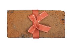 brick in a gift with bow ribbon top view isolated - stock photo