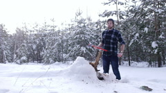 Tired lumberjack standing in winter forest, steam coming out of his mouth Stock Footage