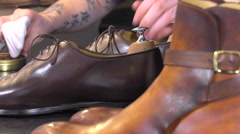 handmade coloring and care of footwear - stock footage