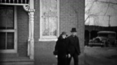 1933: Grandparents walking front yard dressed in black clothes. Stock Footage