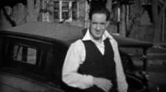 1933: Suave man wearing white collared shirt gets embarrassed. Stock Footage