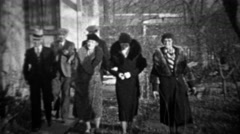 1933: Men greeting women tipping cap bowing to pretty wifes. Stock Footage