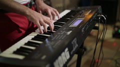 Musician playing keyboard at the party. Close-up. Stock Footage