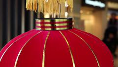 Traditional Chinese red lantern balancing Stock Footage