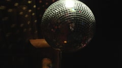 Disco mirror ball turning in darkness Stock Footage