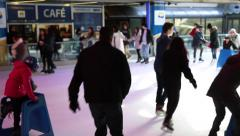 Adults, children ice skating, sunny day Stock Footage