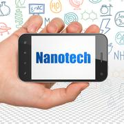 Science concept: Hand Holding Smartphone with Nanotech on display - stock illustration