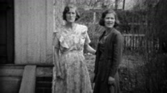 Stock Video Footage of 1933: Mother daughter in formal dress play wrestling in front yard.
