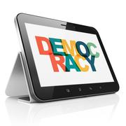 Political concept: Tablet Computer with Democracy on  display - stock illustration