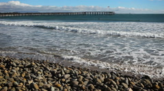 Rocky Beach looking out to Pier Stock Footage