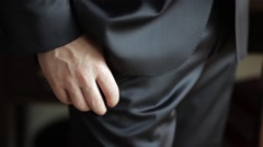 Groom dressed in black suit, standing hand in pocket, and the other keep Stock Footage