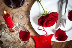 Table setting with red roses on plate - celebrating Valentine's Stock Photos