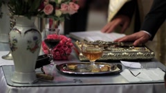 Groom keep hand on the cross and the Gospel, during the religious wedding - stock footage