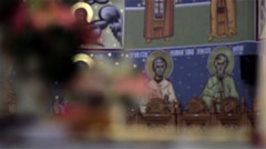 Image of an Orthodox church with saints painted on the walls and glass  Stock Footage