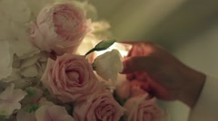 Man kindle candles located in beautiful bouquet of roses sitting on tables 29b Stock Footage