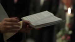 Priest read from the Scriptures during a religious weddings held in the small  - stock footage