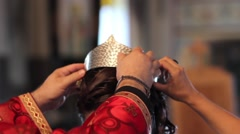 Priest raises crown toward the head bride - stock footage