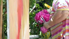 Painter who arranges flowers in vase of peonies, preparing for painting Stock Footage