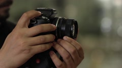 Photographer is it that spins, the ring focus of a lens Stock Footage