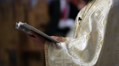 Priest read from the Scriptures during a religious weddings held in the smal Stock Footage