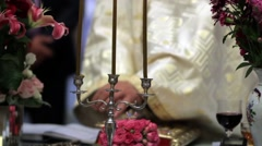 Priest open holy book to read from it during the religious ceremony Stock Footage