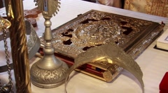 Orthodox priest placed the rings on holy scripture, during the service - stock footage