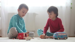 Little children, boys, breaking their piggy bank, emptying all saved money to Stock Footage