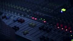 Sound engineer that regulate the sound level from the audio mixer moving - stock footage