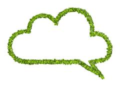 Cloud speech icon from the green grass. Isolated Stock Photos